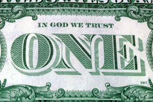 3420887-in-god-we-trust-motto-s-on-the-reverse-of-a-us-dollar-bill